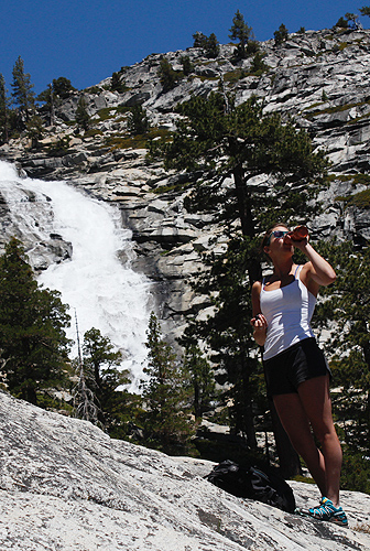 Hiker with Horsetail Falls behind