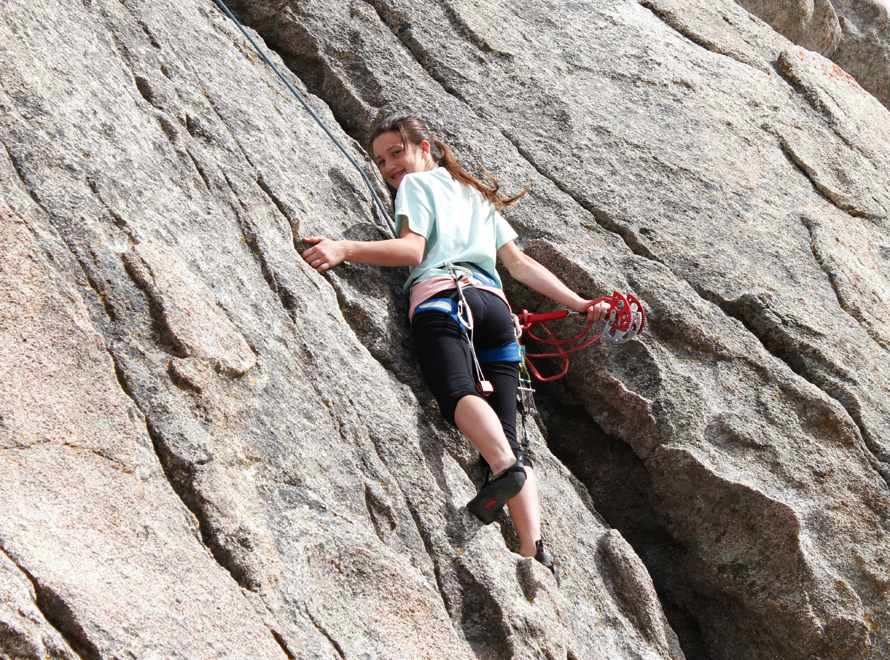 rock climber cleaning gear off a route