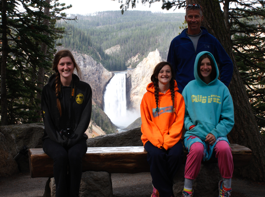 family at yellowstone falls lookout